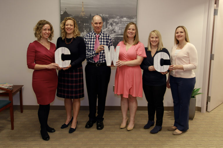 Group Picture of Providers Holding Letters to spell CWC